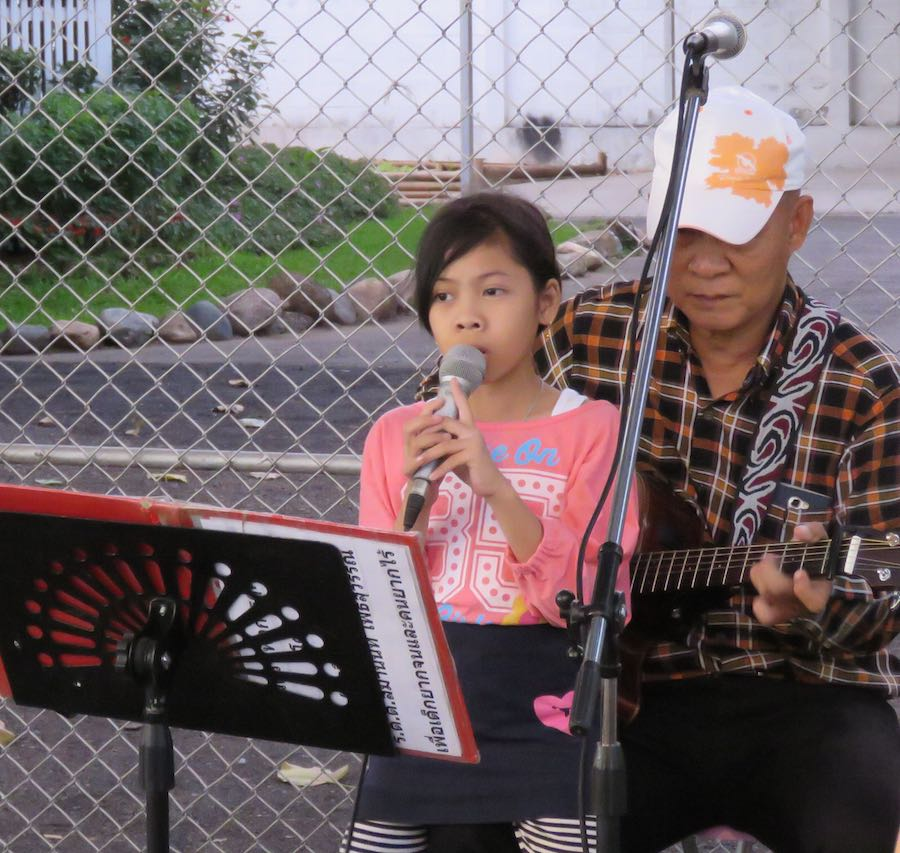 Girl singer (with granddad?) at the Chiang Mai Sunday Market