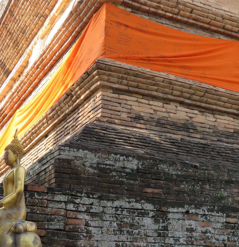 The orange cloth has writing from visitors.