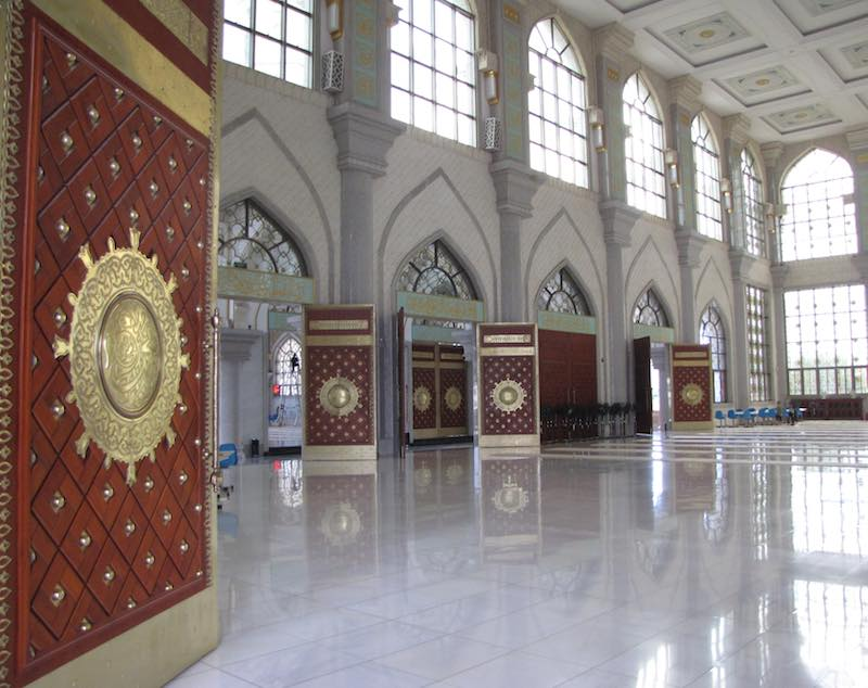 view of the grand hall showing doors, windows and marble floor.