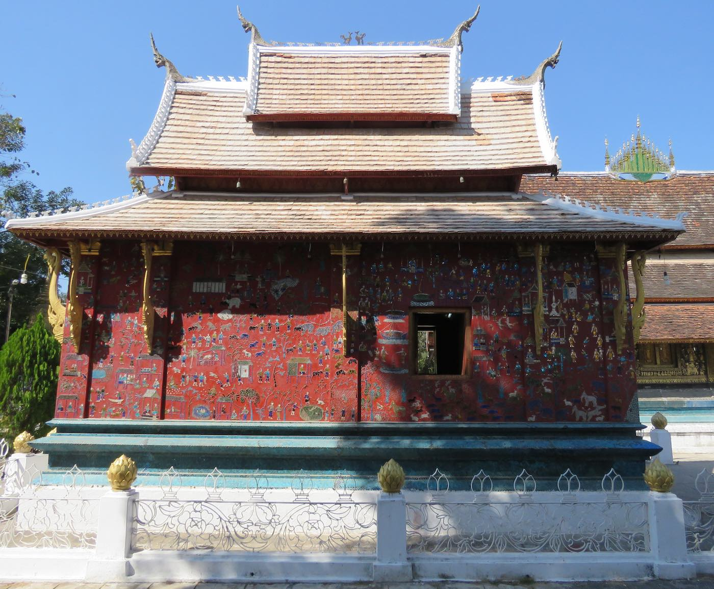Wat Xieng Thong temple building with mosaic covered exterior walls