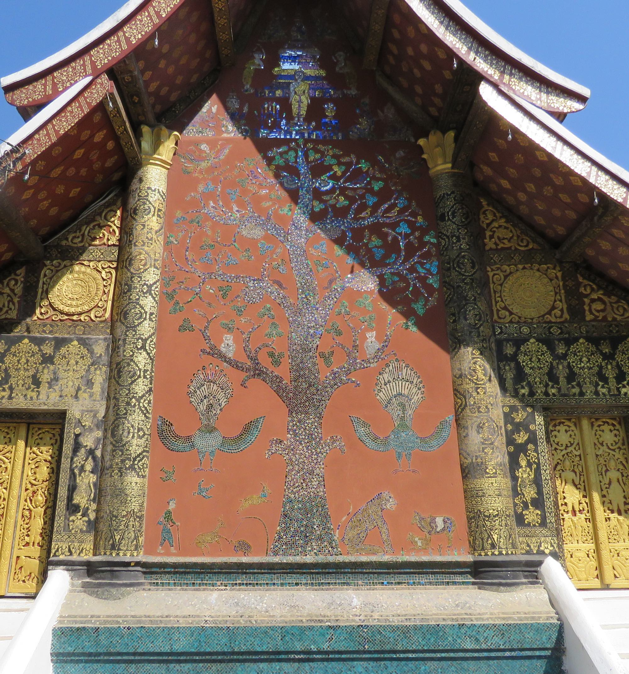 Wat Xieng Thong temple building wall with huge tree mosaic