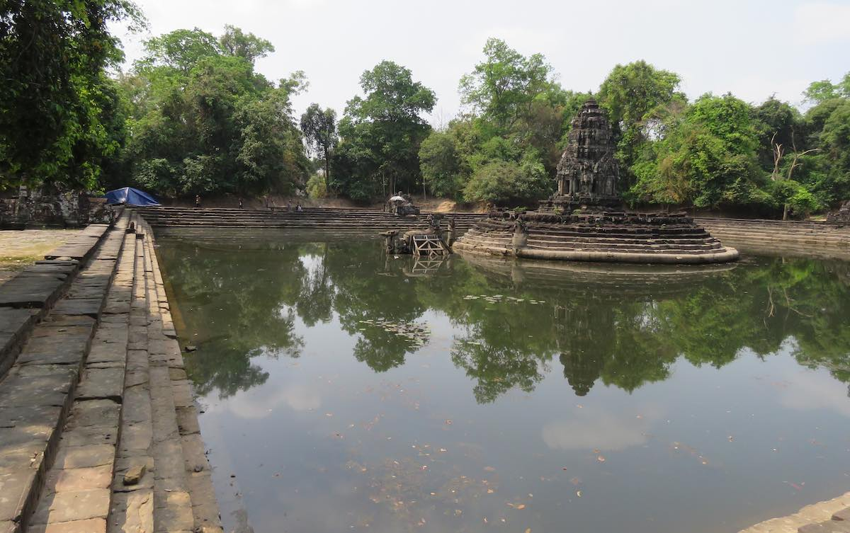 photo of water temple (large pool of water with stairs into the water and a central stone structure)