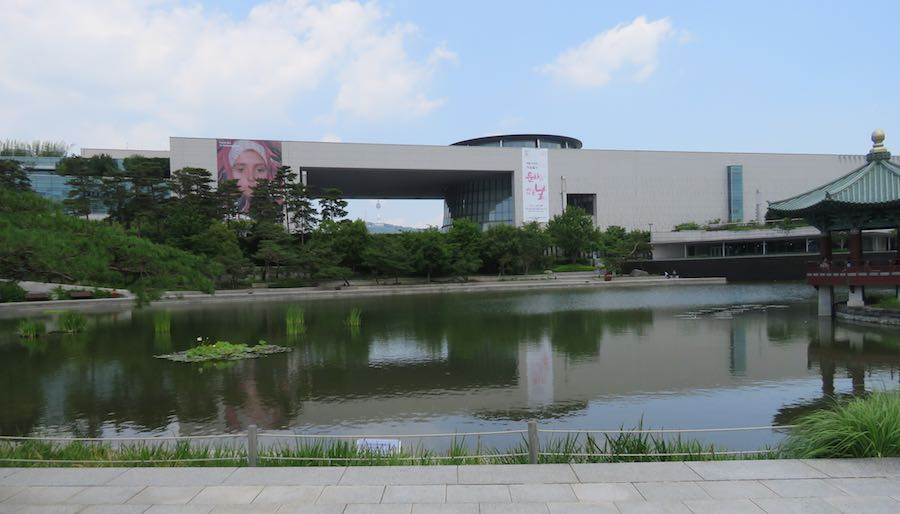view of the National Museum of Korea with a pond in the foreground