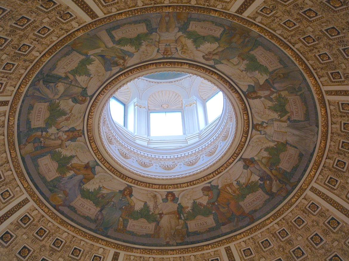 painted ceiling with light shining through windows of dome above