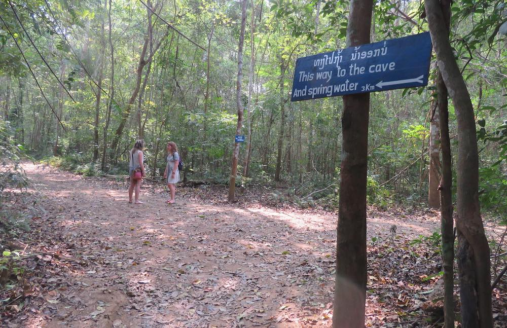 sign and trail to the cave