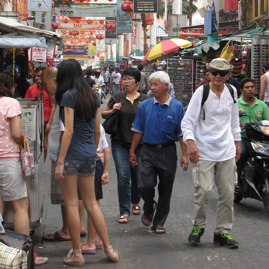 people on the street in Kuala Lumpr, Malaysia