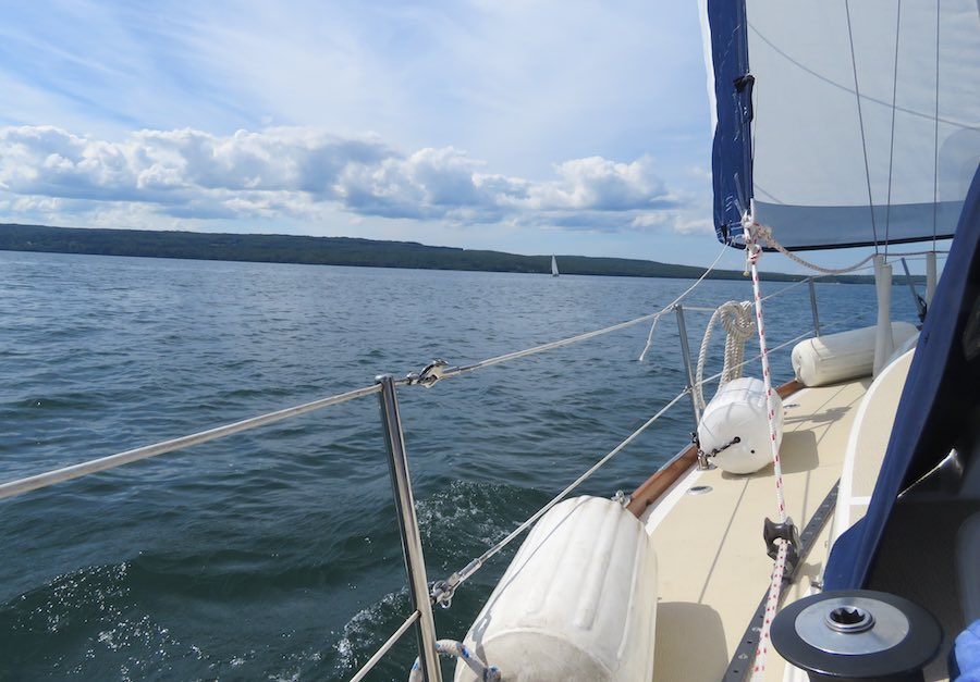 photo from sailboat with view of Lake Superior and clouded blue sky