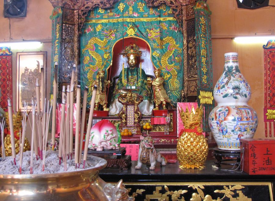 statues and burning incense at Chinese Temple