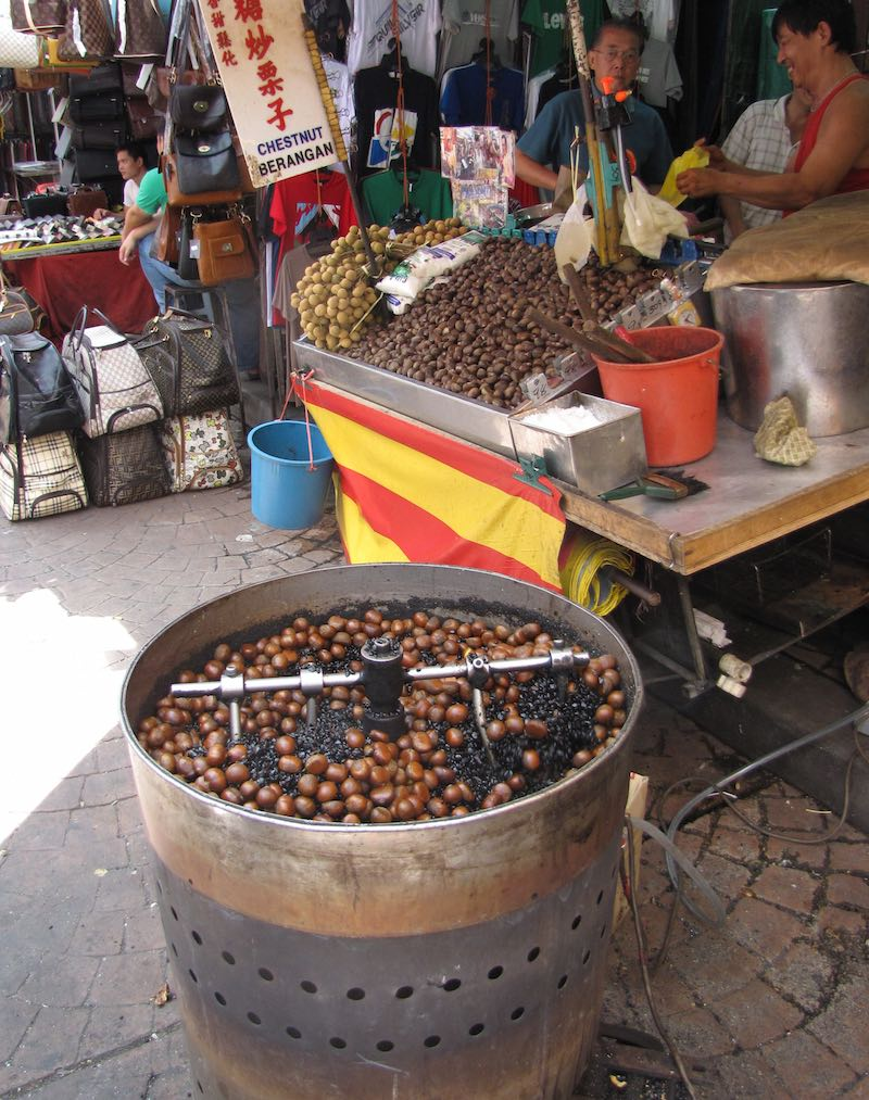 Roasting Chestnuts at street market, Kuala Lumpur