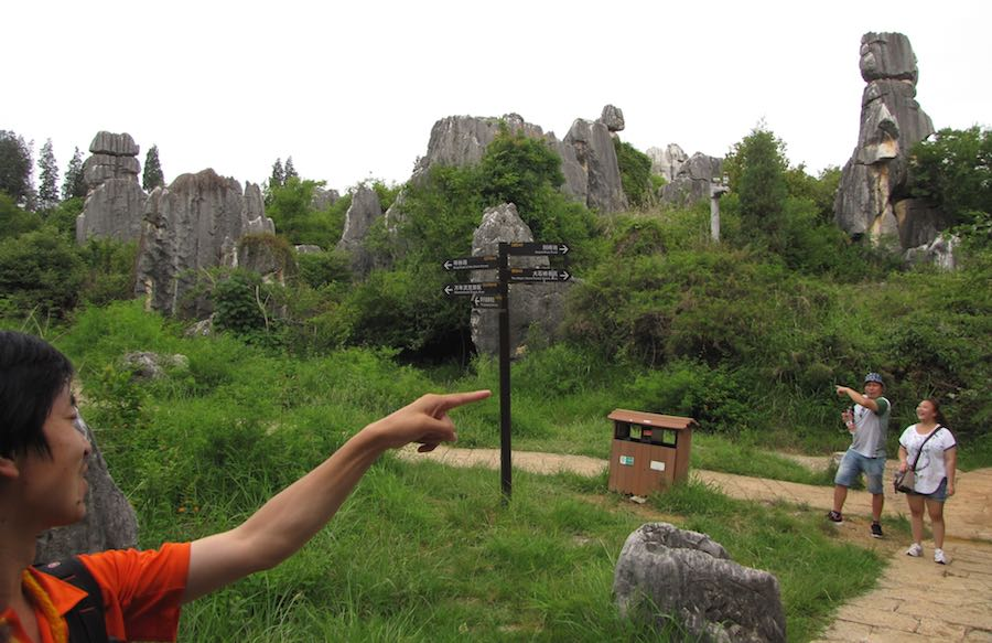 photo of stone forest trails and signpost with my guide a couple tourists